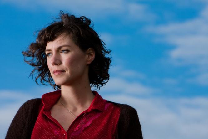 Catherine MacLellan in front of blue sky