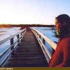 Credit: Edoardo Lapegna - Catherine in knit winter clothes on bridge with sunset