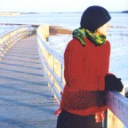 Credit: Edoardo Lapegna - Catherine in knit winter clothes on bridge with snowy fields