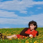 Credit: Jule Malet-Veale - Catherine lying in field against blue sky