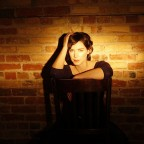Credit: Rob Waymen - Catherine sitting in chair against brick wall
