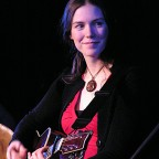 Credit: Paul & Pam Samson - Catherine playing acoustic guitar at ECMA 2006